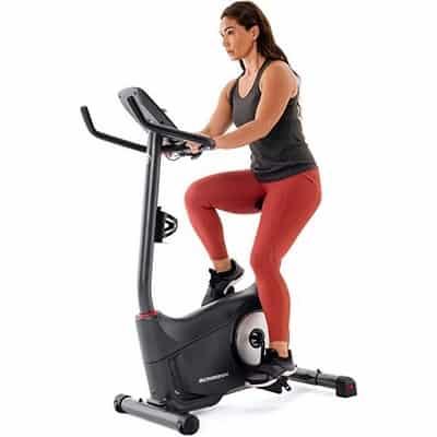 Woman on schwinn 130 upright bike
