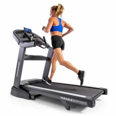 Woman running on horizon t7.8 treadmill