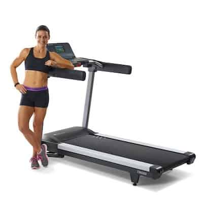 Woman standing next lifespan fitness t6000i treadmill