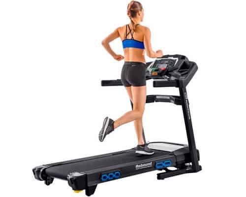 Woman running on the nautilus t618 treadmill