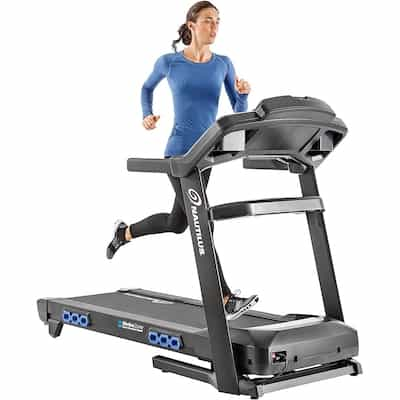 Woman running on nautilus t618 treadmill