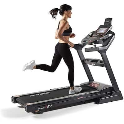 Woman walking fast on sole f63 treadmill