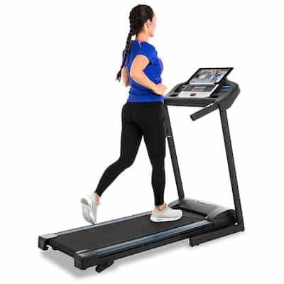 Woman walking on xterra tr150 treadmill