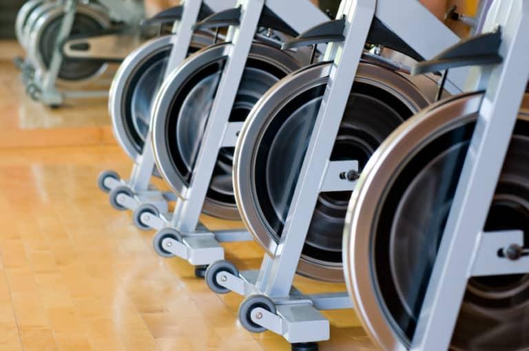 row of exercise bike flywheels